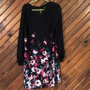 Black dress with floral print. Never worn.